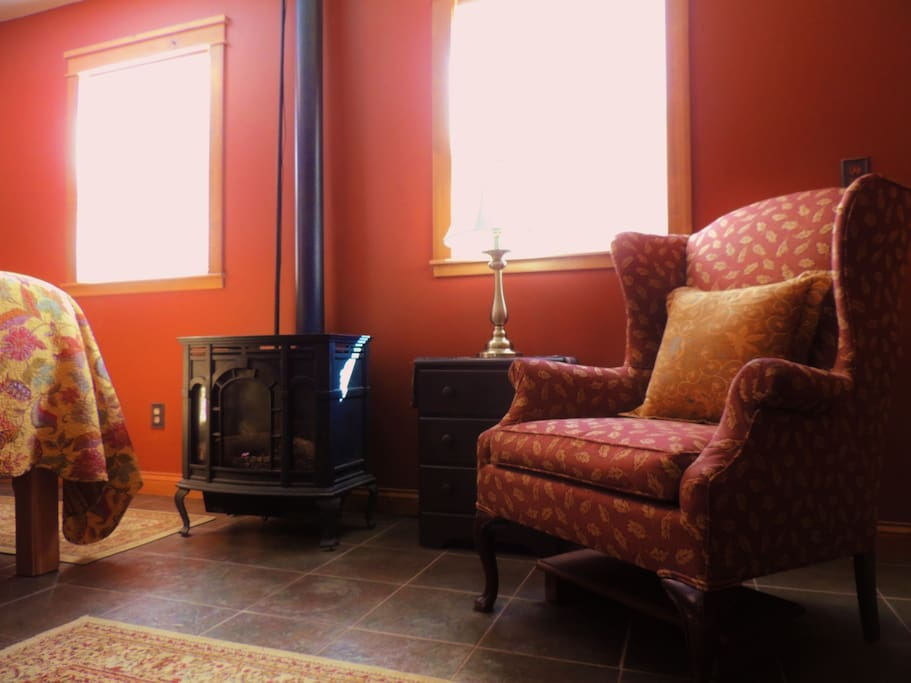 Relax in an  easy chair by the propane fireplace