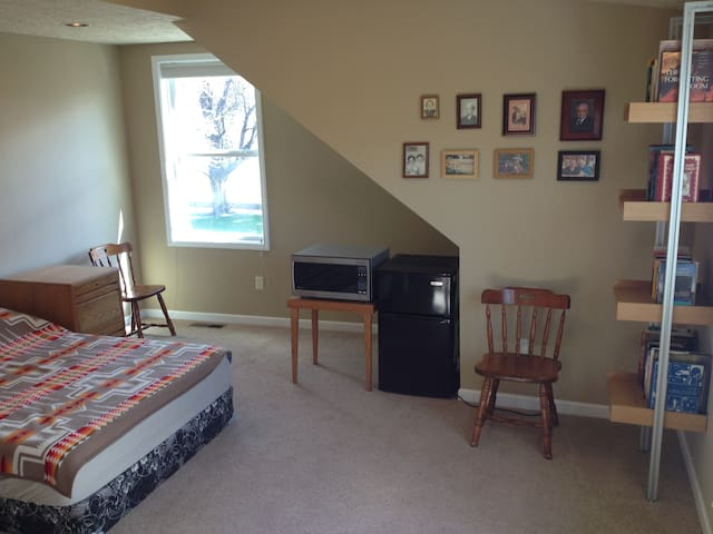 The room is equipped with microwave and mini fridge, and the full-sized mattress is brand new.