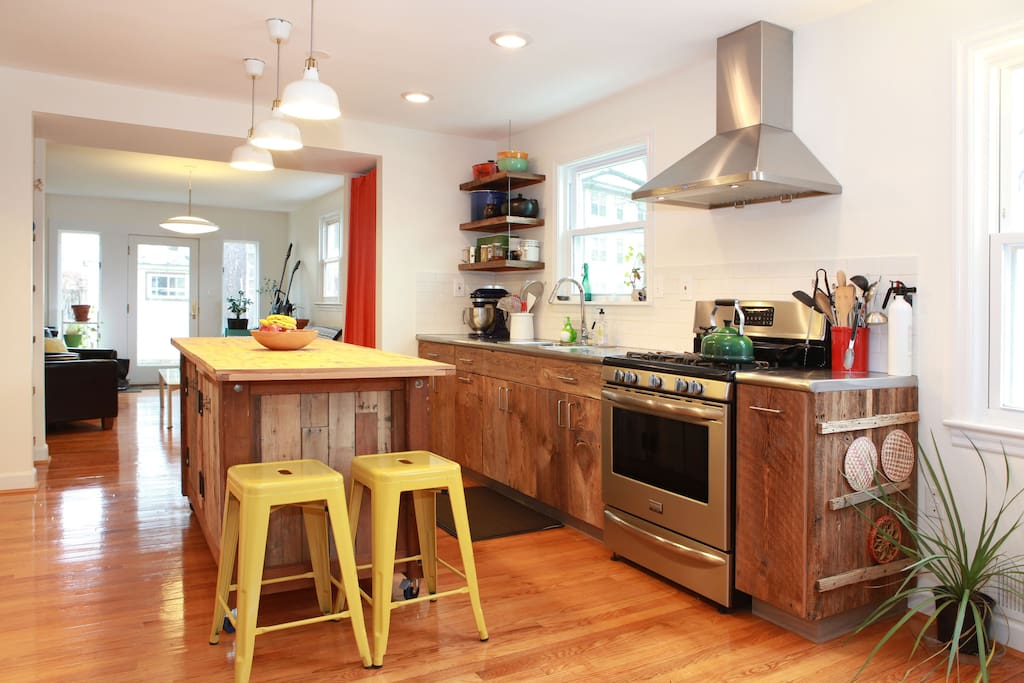 The island and cabinets fronts were handmade from reclaimed wood.