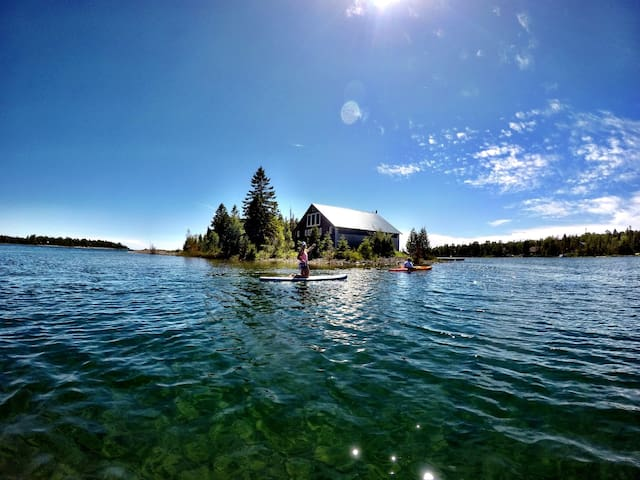 Johnson's Harbour opens right out to Lake Huron. Explore this view on the kayaks provided.