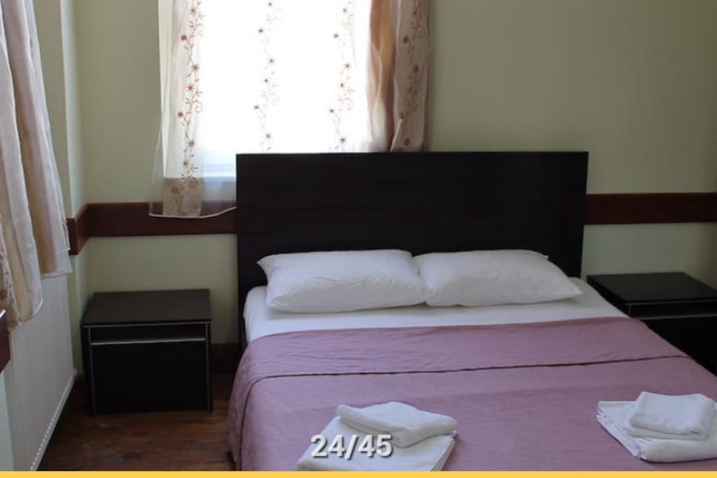 double bed in a private room with wardrobe heating and free wi-fi...