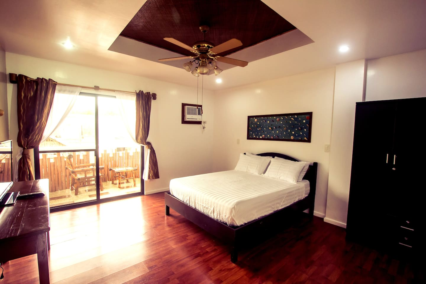 Spacious room and comfortable pillow top mattress. Balcony with seating area.