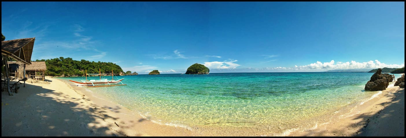 Enjoy the allure of the Ilig-iligan beach. A quiet beach paradise away from the noisy crowds.The water is pristine with azure blue that invites you to swim and play.Marine life is abundant that makes this a perfect place to snorkel.