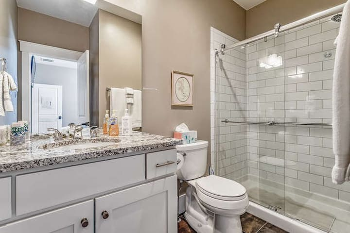 Private bath with granite countertops & tile floors includes towels, shampoo, conditioner, body wash