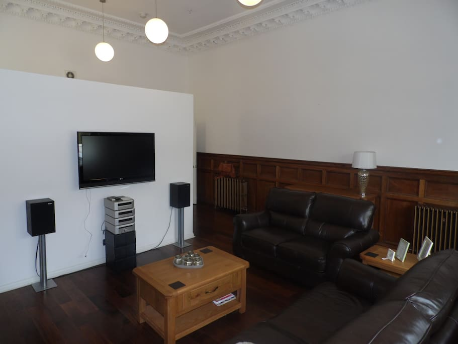 Lounge area with TV and sound system