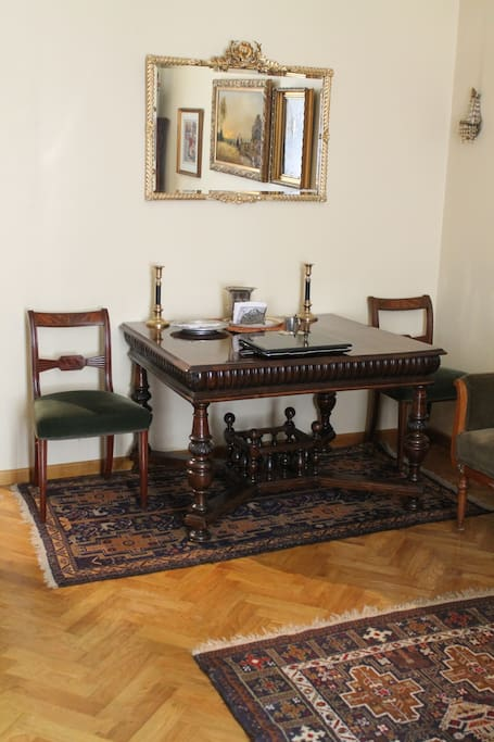 Big antique table wit chairs. You will find also 3 armchairs in the apartment.