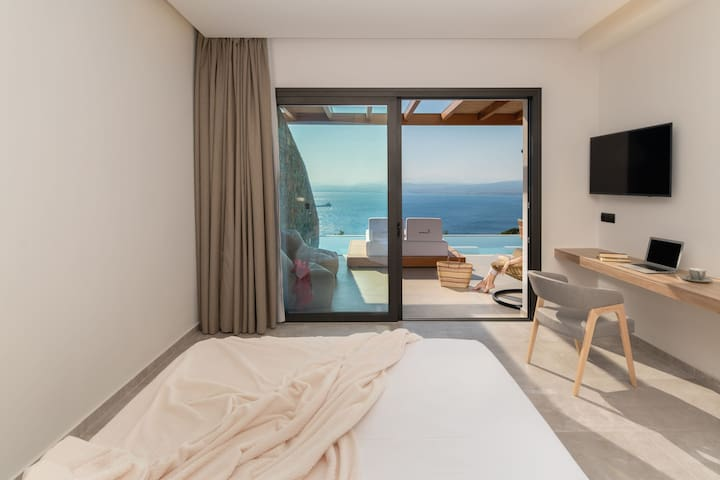 Floor-to-ceiling glass doors offer beautiful sea views and access to the pool!
