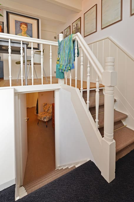 The little stairs lead to the lower floor where you will find the bedroom, bathroom and kitchen.
