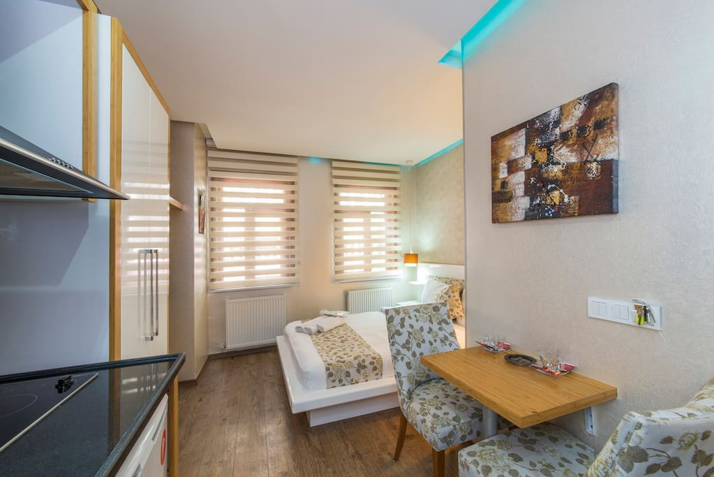 Kitchen - Uniquely decorated with LED lights in different colors, this stylish suite has a full kitchen, dining area, sofa and a private bathroom with free toiletries. Room Facilities: City view, Telephone, Fax, Radio, Satellite channels, Flat-screen TV,
