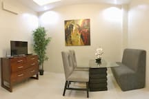Living/Dining room w/ a flat screen LED TV for your entertainment.