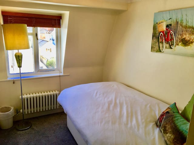 The second bedroom with comfy single bed, sloping floors and lovely views.