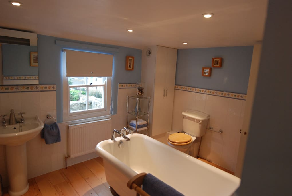 Spacious bathroom with roll top bath and separate shower