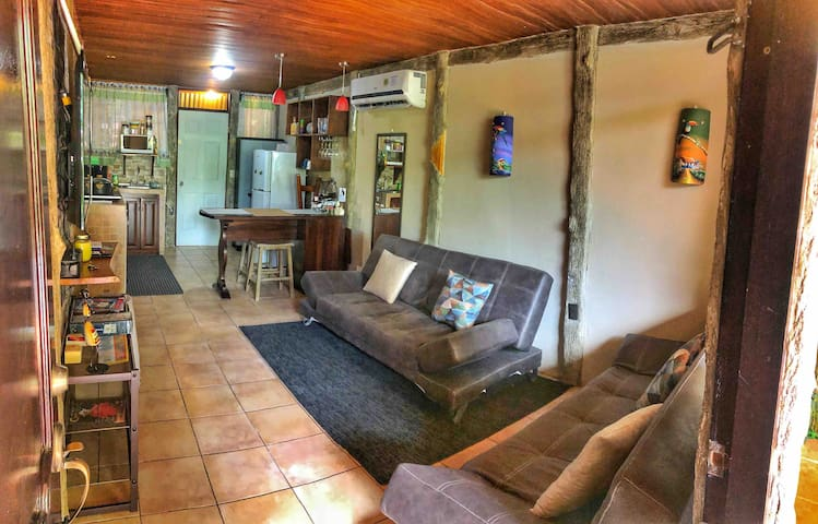 The cozy  living room area connects to a fully stocked kitchen area, divided by a counter top that can be used as dining area, definitely a warm place to enjoy, two sofa-beds that turns into full beds in case of groups of 5+ and a Smart T.V.