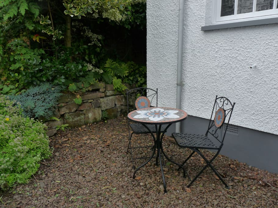 Small outdoor seating area perfect for morning coffee and evening drinks....