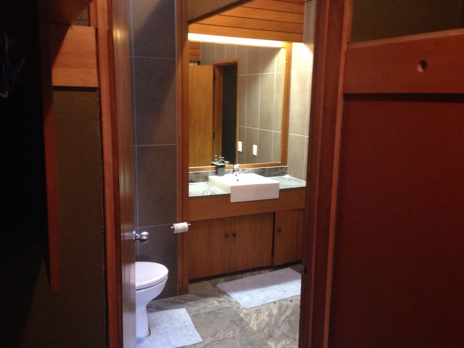 Ensuite , hot shower , heater , toilet and towel rack.