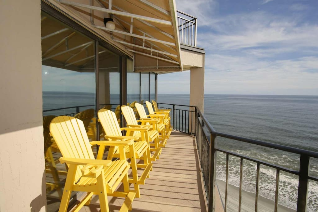 Line up to survey beach activities or spot dolphins with morning coffee or evening beverages.  Each sturdy chair has a cup holder.