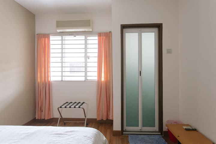 Upstairs Bedroom 1: All rooms are air-conditioned to combat the heat.