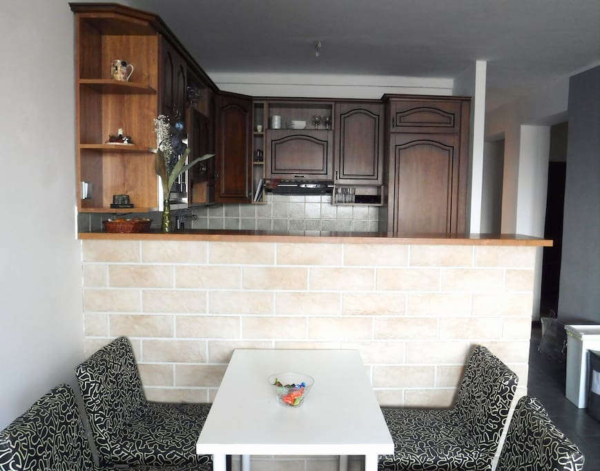 The kitchen with the dining space