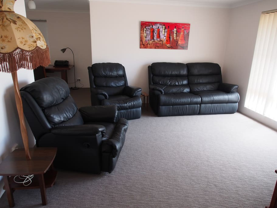 Comfortable lounge room with 4 recliners