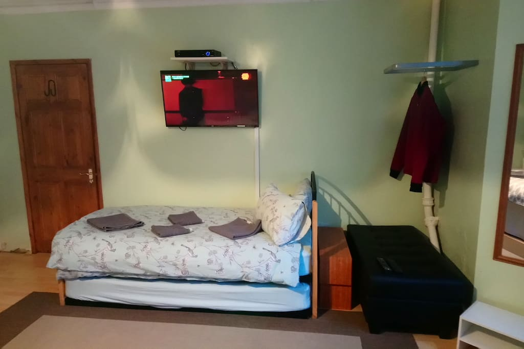 Two single beds on other side of room