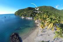 Just walk down to the quaint beach of Marigot Bay!