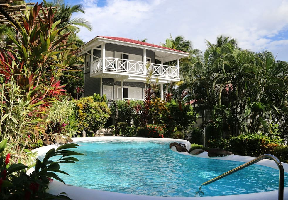 Enjoy a shared community pool and lounge chairs..