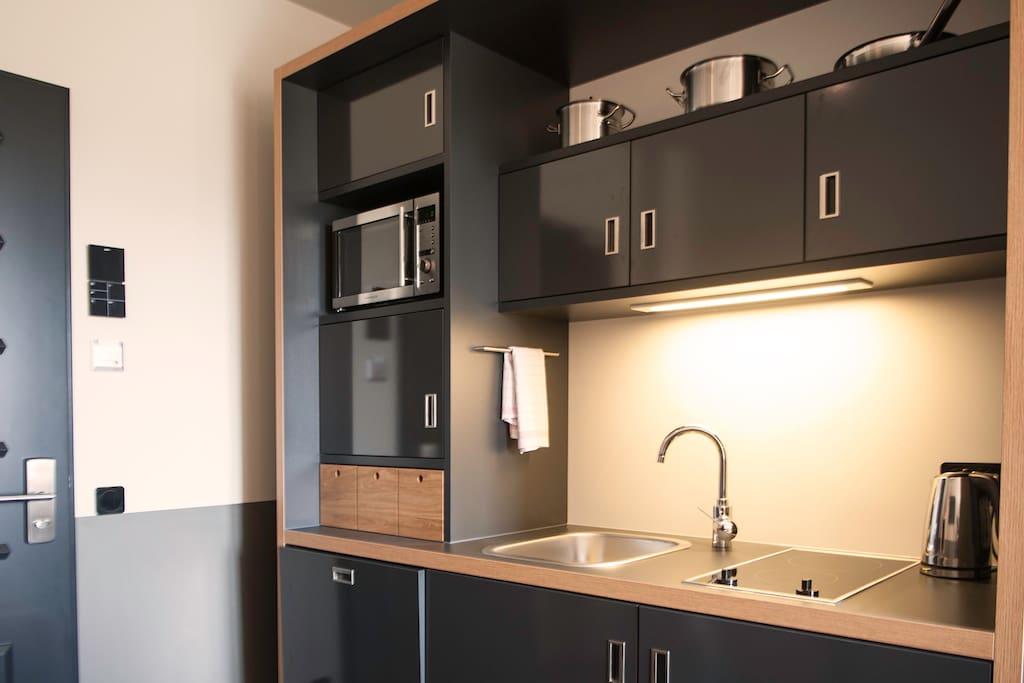 Die Kitchenette ist voll ausgestattet. Inklusive Nespresso-Kaffee, kannst Du dich nach belieben selbst versorgen.