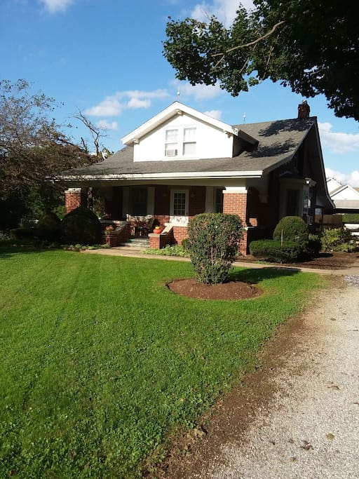 Front of home with large front porch to enjoy the fresh country air