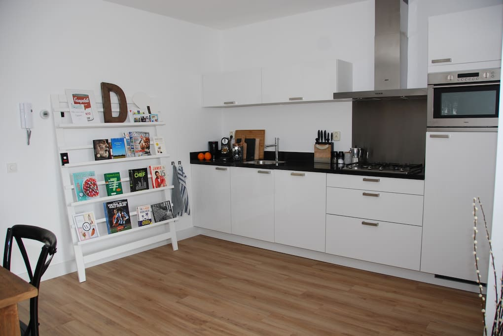 New kitchen with a lot equipment