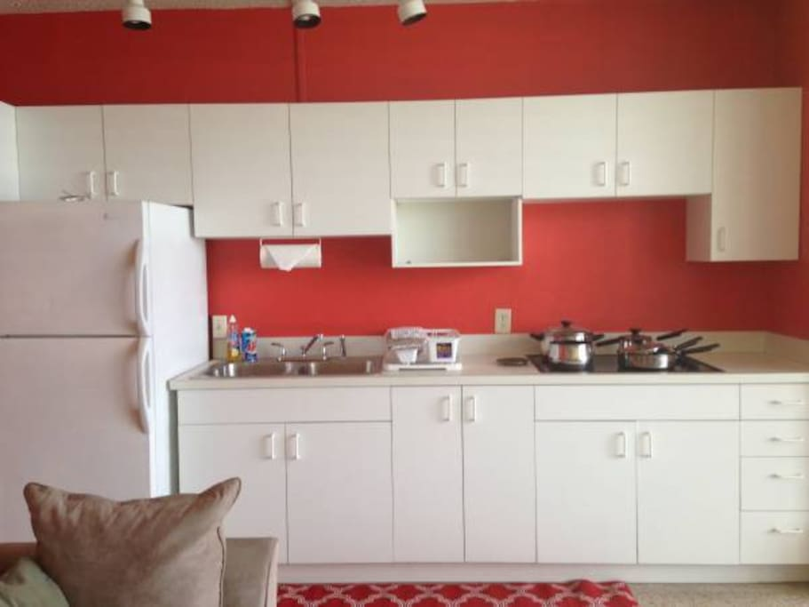 Kitchenette with stove top, microwave and small appliances
