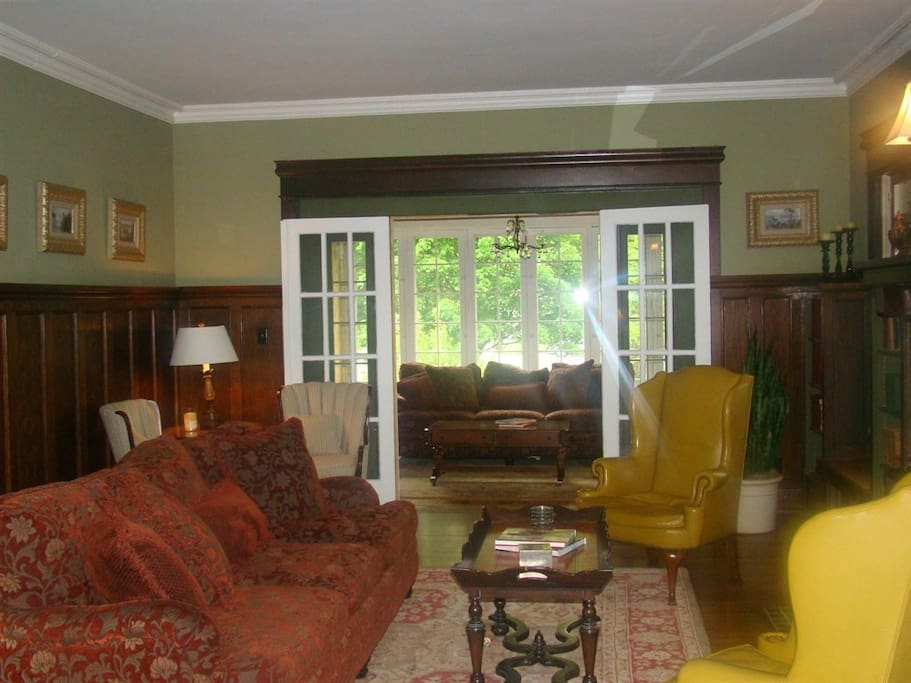 Living Room w/ sunroom beyond the french doors.