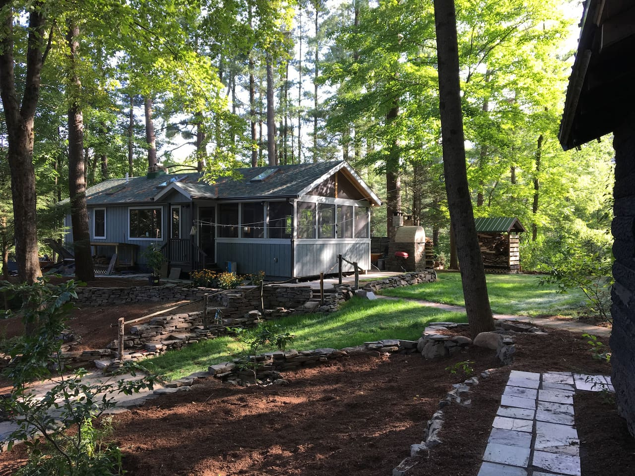 2 bedroom cabin in a private setting, with hot tub, outdoor fireplace, pizza oven,and separate writer's studio