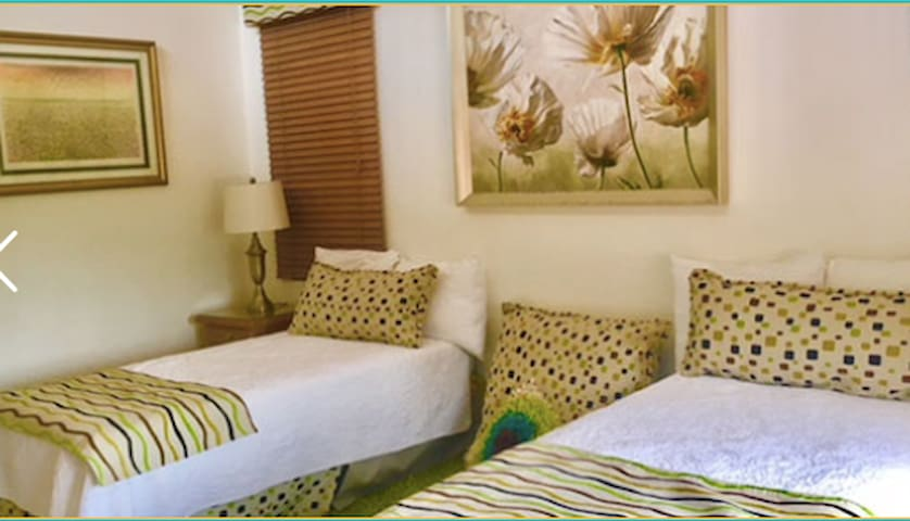 Second Bedroom: Two Twin Beds; Bedside Tables and Lamps – plus thematic window sconces
