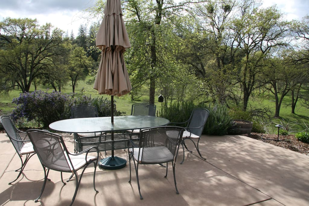The patio overlooks a  stunning landscape.