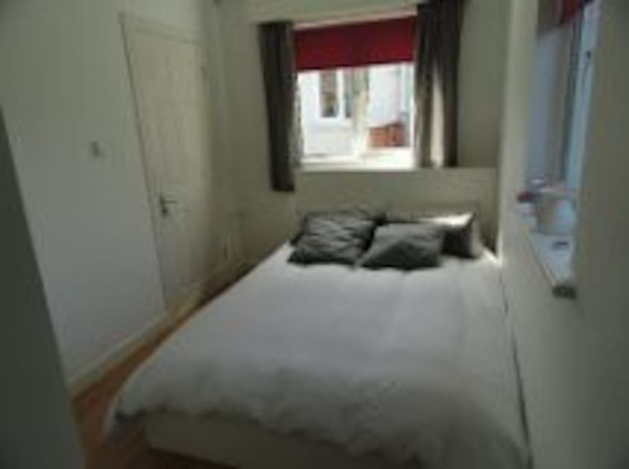 comfortable double bed, wardrobe, linen and towels provided