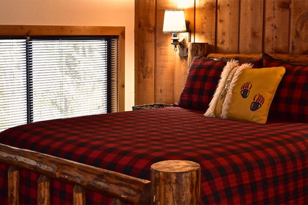 Our rustic loft room offers two queen-size beds.  Here's one of them.