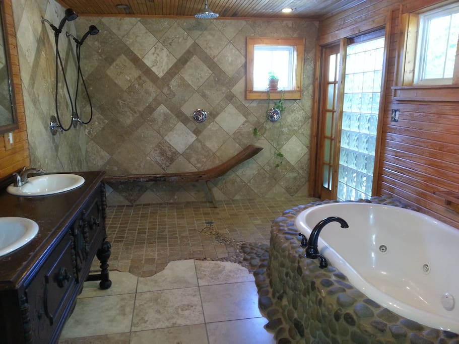 Custom Bathroom with jet tub, dry sauna, rain shower & outside  balcony w/private shower