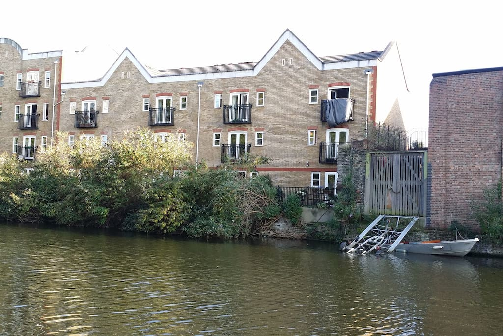 Appartment is on bottom 2 floors with access to garden, overlooking the canal