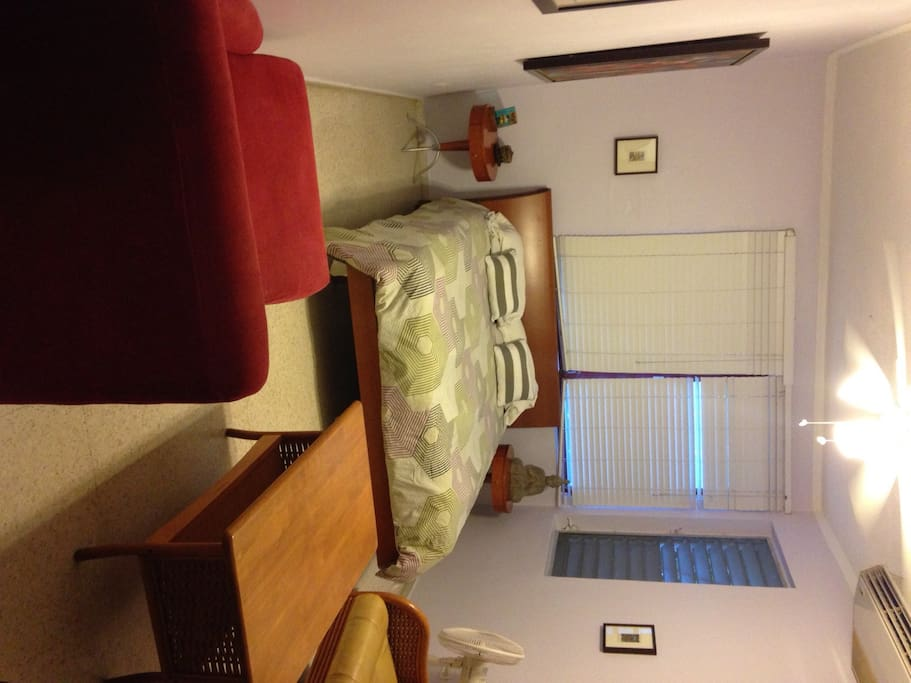 Queen size bed, 2 night tables in large comfortable room