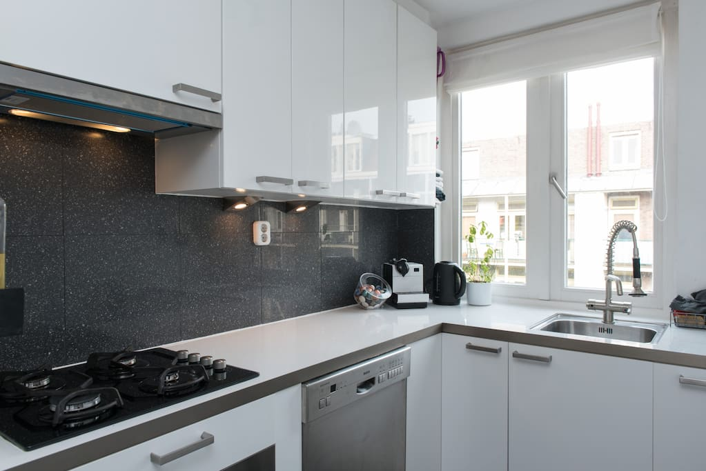 Bright kitchen equipped with all cooking facilities at your kind disposal