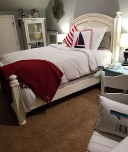 Room #4 is a cozy, charming nautical themed room.