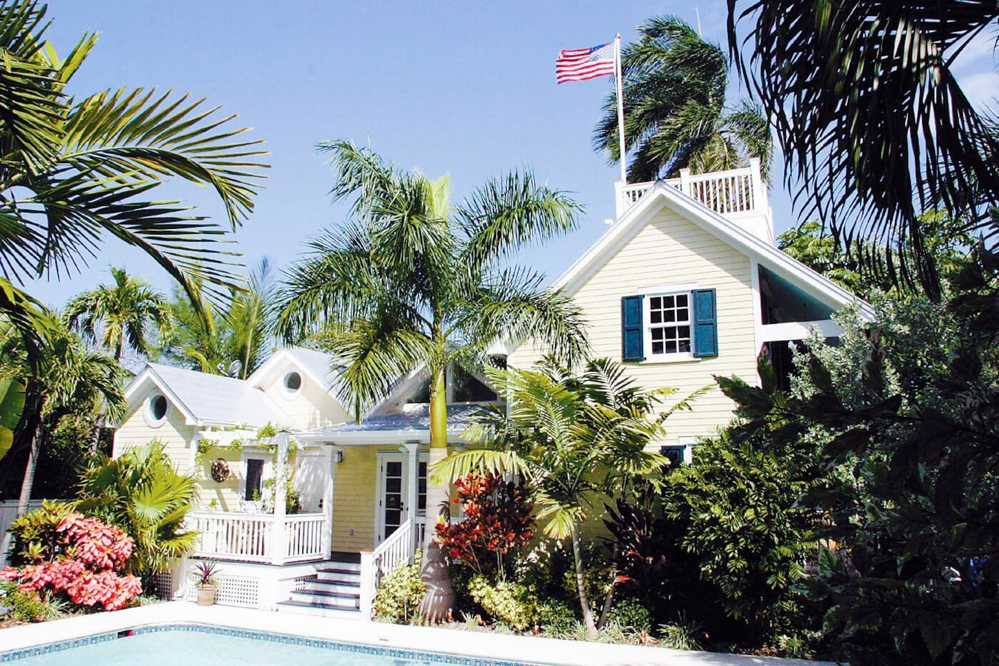 Paradise Key West style with a top floor observation deck on the harbor to the right by the flag.