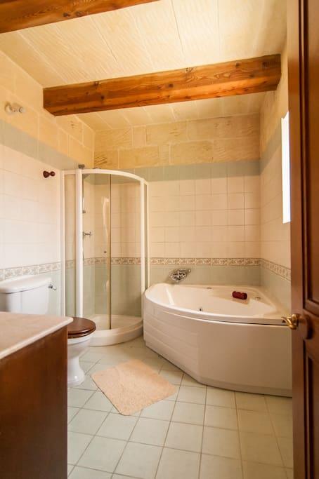 Main bathroom with a jacuzzi on first floor