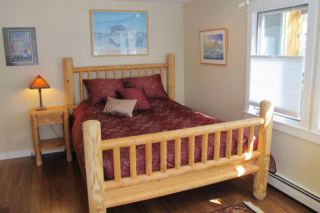 Spacious private bedroom features a queen bed and...