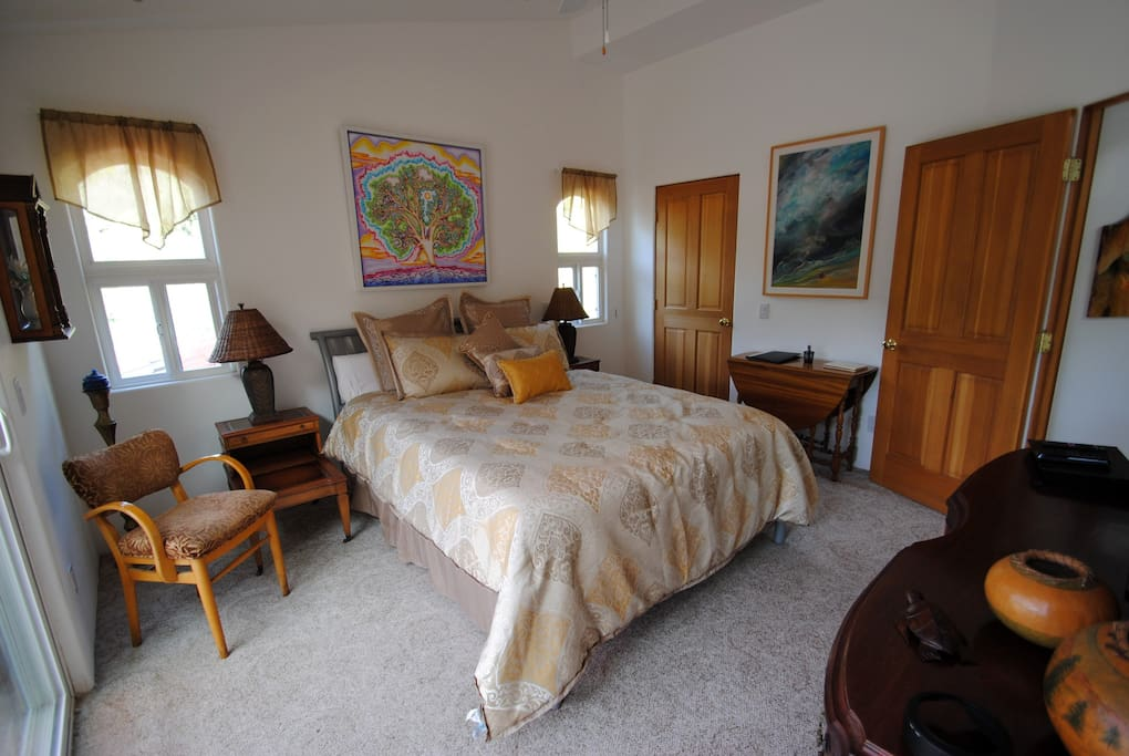 "Master Bedroom decorated with fine art; 39"" HDTV & free movies and mini frig"