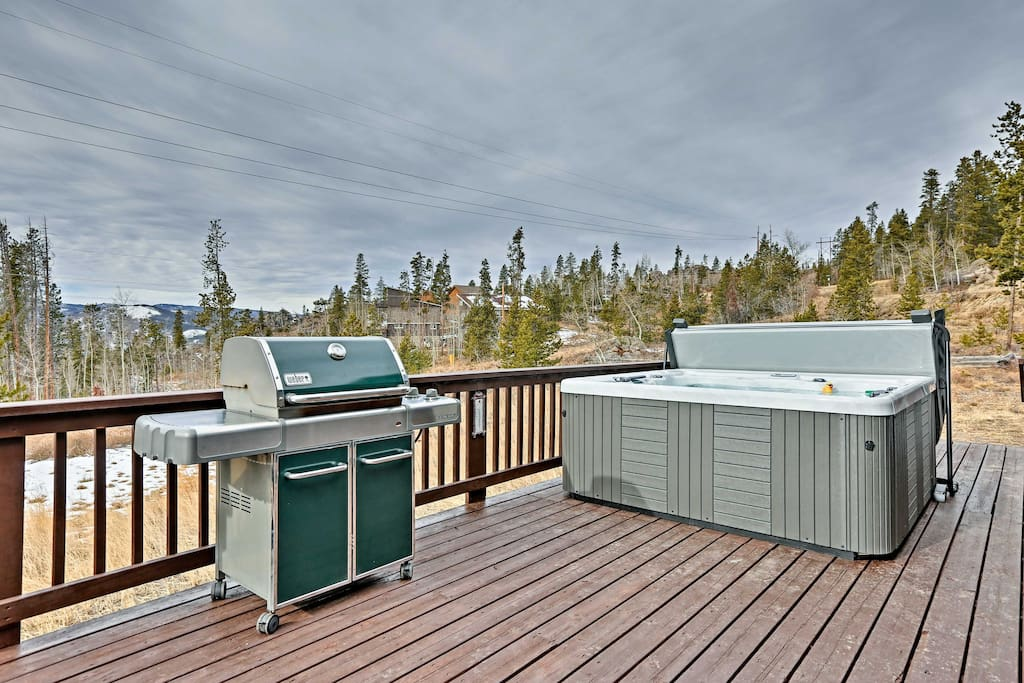 While basking in the mountain views, soak in the hot tub or grill on the deck!
