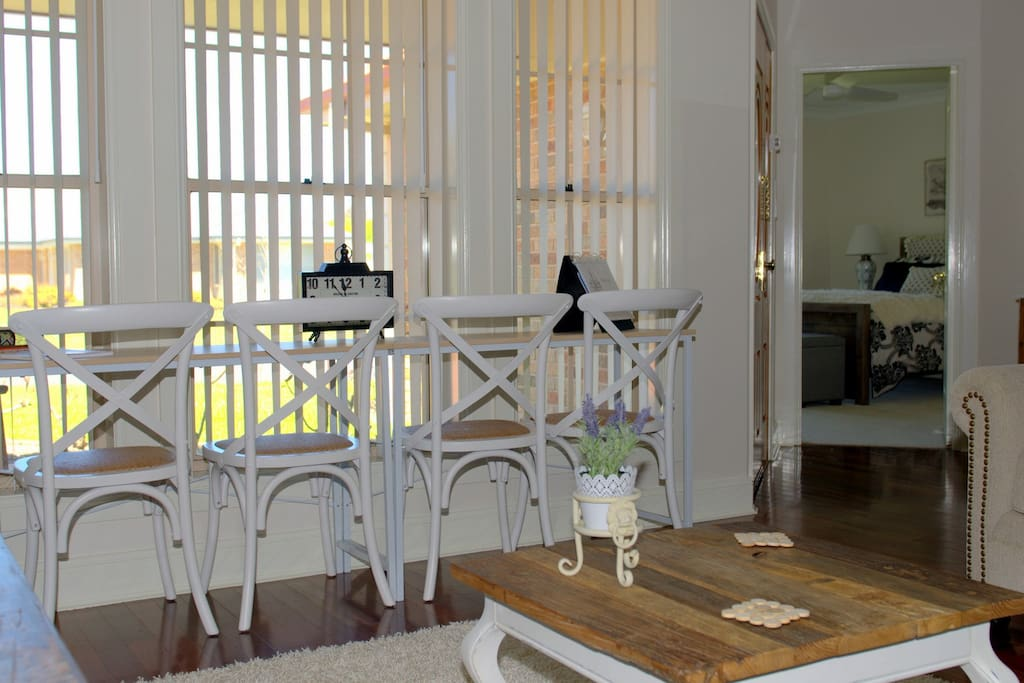My My... Café bench style dining for 4, located at the front of the B&B. The Master bedroom can be seen in the distance.