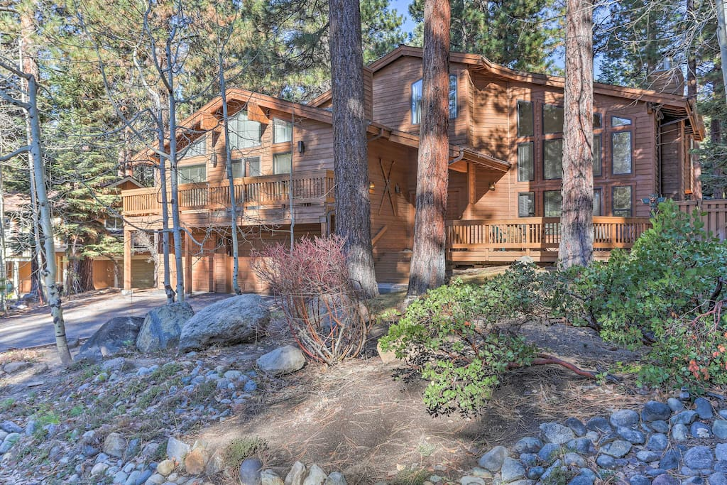 Beautiful landscaping and large trees dominate the yard of Lake Tahoe home.