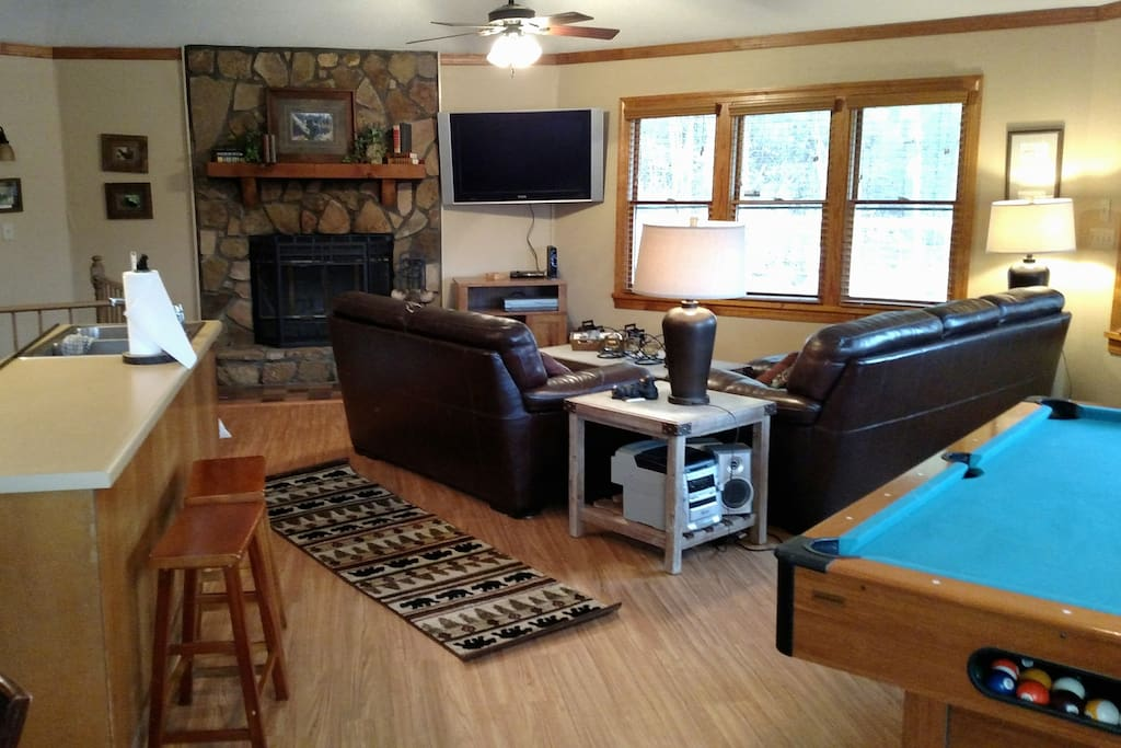 Great room area with fireplace, tv and Pool table