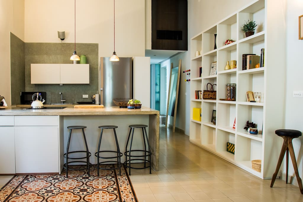 Kitchen + library + fabulous patterned tiled flooring